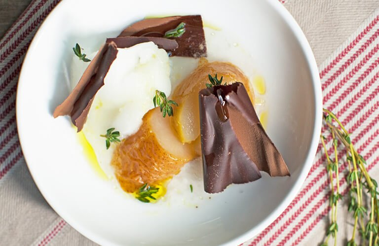 Poached pear, lemon-thyme sorbet, and chocolate shavings